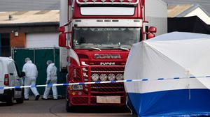 Police officers in forensic suits at the scene where the lorry containing 39 dead bodies was found. Photo: BEN STANSALL/AFP via Getty Images