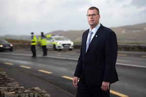 Garda Brendan O'Connor of the GRA at a                   garda checkpoint in Dunfanaghy, Co Donegal. Picture:                   Joe Dunne
