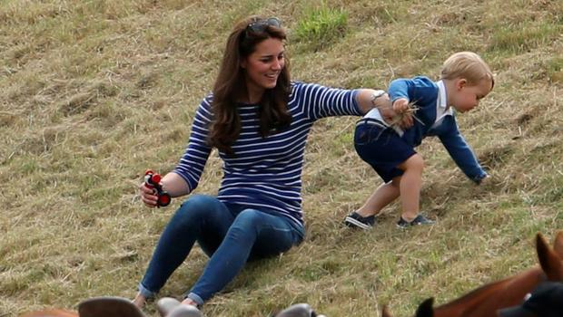 June 2015: The Duchess of Cambridge with Prince George, as the Duke of Cambridge and Prince Harry take part in a charity polo match at Beaufort Polo Club in Tetbury, Gloucestershire. PRESS ASSOCIATION Photo. Picture date: Sunday June 14, 2015. Photo credit should read: Steve Parsons/PA Wire