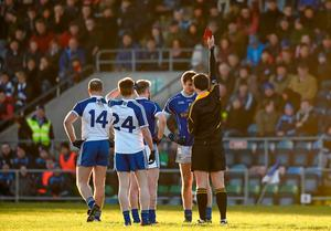 Cavan's Gearoid McKiernan is shown a red card by referee Sean Hurson for verbally abusing Monaghan's Drew Wylie. The Cavan man accepted a two-match ban and has conveyed a personal apology to Wylie. Photo: Paul Mohan / SPORTSFILE