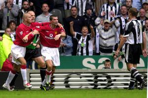 Manchester's Roy Keane is held back by David Beckham after a confrontation with Newcastle's Alan Shearer during the FA Barclaycard Premiership game between Newcastle and Manchester United at St James Park in 2001.