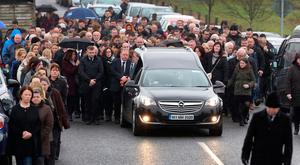 Family and friends follow the hearse carriyng the remains of Emma O Keeffe from St John the Baptist Church after her funeral mass in Kilberry Co Meath. Photo: Frank Mc Grath