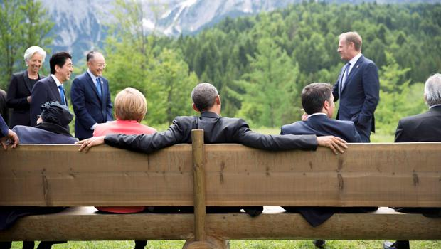 German Chancellor Angela Merkel sits with U.S. President Barack Obama on a bench outside the Elmau castle in Kruen near Garmisch-Partenkirchen, Germany, June 8, 2015. Leaders of the Group of Seven (G7) industrial nations vowed at a summit in the Bavarian Alps on Sunday to keep sanctions against Russia in place until President Vladimir Putin and Moscow-backed separatists fully implement the terms of a peace deal for Ukraine.          REUTERS/Michael Kappeler/Pool