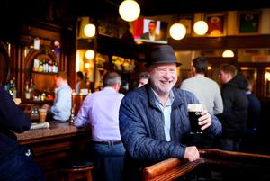 Thirsty work: Liam Collins enjoying a pint of Guinness in The Swan on Aungier Street, Dublin. Photo: David Conachy
