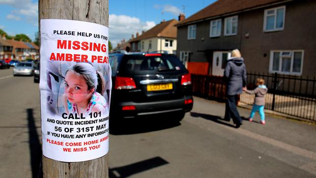 A poster attached to a telegraph pole appeals for information about  missing teenager Amber Peat, 13, from Bosworth Street in Mansfield. Amber Peat/PA Wire