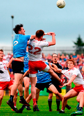 UP FOR GRABS: Dublin's Michael Darragh Macauley competes in the air with Tyrone's Declan McClure during Saturday's All-Ireland SFC quarter-final Group 2 match at Healy Park, Omagh. Photo: Stephen McCarthy/Sportsfile
