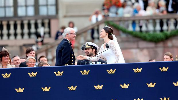 STOCKHOLM, SWEDEN - JUNE 13:  Princess Sofia of Sweden and  Prince Carl Philip of Sweden are congratulated by King Carl XVI Gustaf of Sweden after their marriage ceremony on June 13, 2015 in Stockholm, Sweden.  (Photo by Ragnar Singsaas/Getty Images)