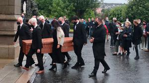 John Hume's coffin is carried into St Eugene's Cathedral. Photo: Niall Carson/PA Wire