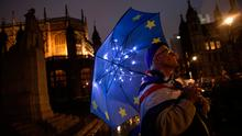 Debate: An anti Brexit campaigner holds an EU umbrella outside the Houses of Parliament in London, England. Photo: Dan Kitwood/Getty Images
