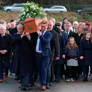 Community in grief: Seamus Mallon's coffin is brought to his home parish church in Mullaghbrack, Co Armagh. Picture: PA