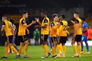 Wolverhampton Wanderers' Willy Boly celebrates with teammates after the Premier League win over Crystal Palace at Molineux