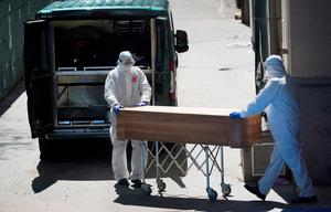 "'Workers push a coffin of a person who died at a nursing home in Leganes, near Madrid, but headlines such as ""Over 800 people die in one day in Spain from Covid-19"" offer absolutely no context.'"