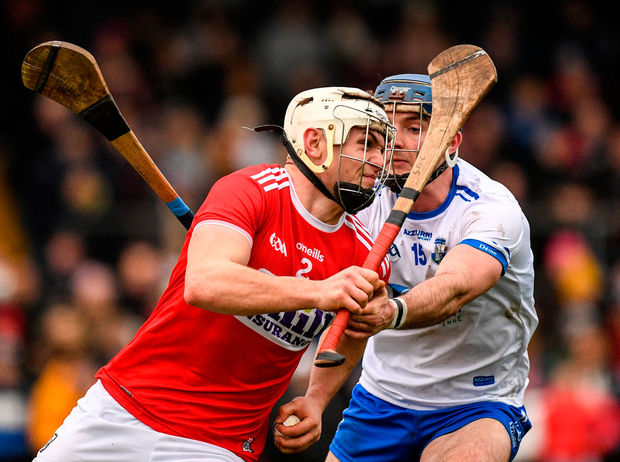 Sean OLeary-Hayes of Cork is tackled by Patrick Curran of Waterford. Photo: Eóin Noonan/Sportsfile
