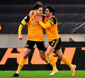 Wolves' Rayan Ait-Nouri (left) celebrates scoring his side's first goal. Photo: PA