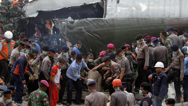 Indonesian security forces and firefighters search through the wreckage of an Indonesian military C-130 Hercules transport plane after it crashed into a residential area in the North Sumatra city of Medan, Indonesia. Reuters/Roni Bintang