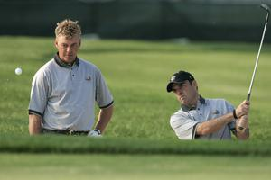 Darren Clarke (L) and Paul McGinley practice for the 35th Ryder Cup Matches at the Oakland Hills in 2004.