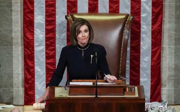 U.S. Speaker of the House Nancy Pelosi (D-CA) looks out at the House of Representatives as she gavels the House out of session after representatives voted in favor of two counts of impeachment against U.S. President Donald Trump in the House Chamber of the U.S. Capitol in Washington, U.S., December 18, 2019. REUTERS/Jonathan Ernst