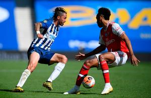 Brighton and Hove Albion's Ezequiel Schelotto (left) and Arsenal's Pierre-Emerick Aubameyang battle for the ball. Photo: Mike Hewitt/PA Wire/NMC Pool