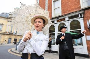 In character: Darina Gallagher as Molly and Paddy Keogh as James Joyce outside Sweny's Chemist during a Bloomsday event on Westland Row in Dublin. Photo: Gerry Mooney
