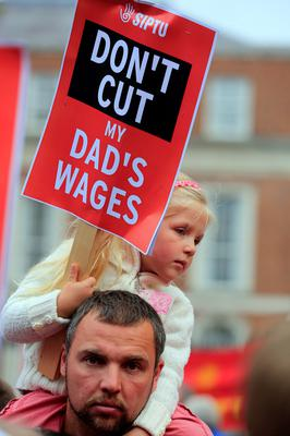 Rafal Furmanczyk and daughter Tosia, age 9, Tallaght with Greyhound bins workers march on City Hall to protest in support of the workers on strike at Greyhound Bins. Picture:Arthur Carron