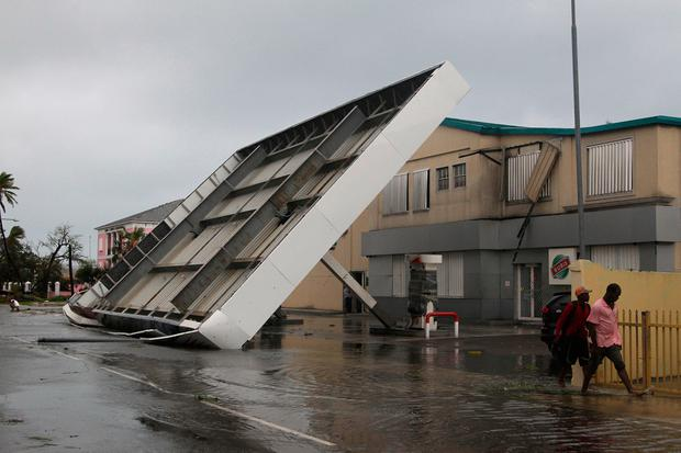 The roof of a gas lays collapsed in the aftermath of Hurricane Matthew in Nassau, Bahamas, Thursday, Oct. 6, 2016. (AP Photo/Tim Aylen)