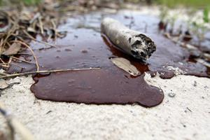 Thick oil is seen washed ashore from the Deepwater Horizon oil spill in the Gulf of Mexico. According to a US judge's ruling the final cost of the disaster may cost BP approximately $50bn.  Photo credit: Joe Raedle/Getty Images