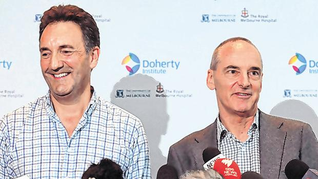 Dr Mike Catton (right) and Dr Julian Druce speak to the media during a press conference at the Doherty Institute in Melbourne. Photo: Getty Images)