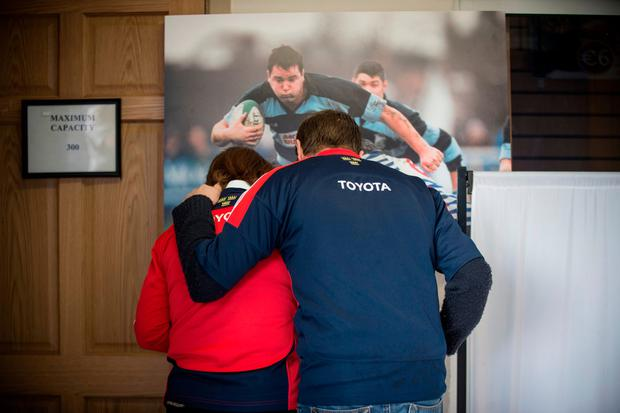 Munster fans sign the book of condolence at Thomand Park. Photo: Mark Condren