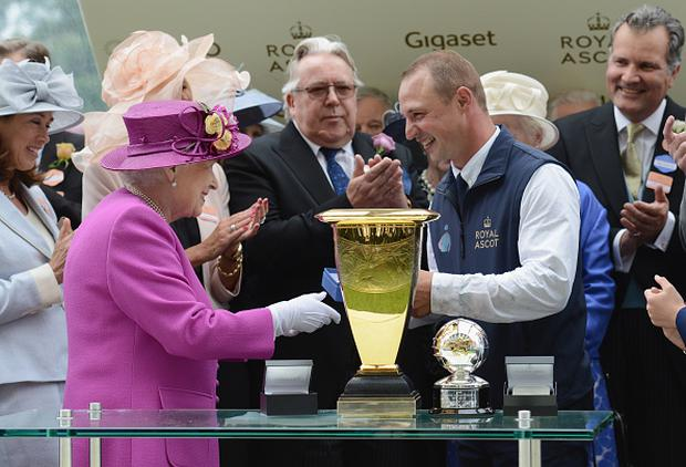 Queen Elizabeth II presents the Diamond Jubilee Stakes Cup after The Tin Man wins, ridden by Tom Queally on day 5 of Royal Ascot 2017 at Ascot Racecourse on June 24, 2017 in Ascot, England. (Photo by Kirstin Sinclair/Getty Images for Ascot Racecourse)