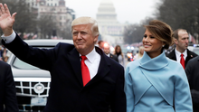 President Donald Trump waves as he walks with First Lady Melania Trump during the inauguration parade on Pennsylvania Avenue in Washington Picture: Reuters