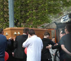 Mourners carry the coffin of Glen Osborne at his funeral in Dublin