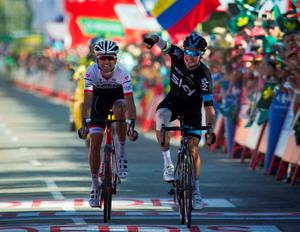 Sky's Irish cyclist Nicolas Roche celebrates as he crosses the finish line next to Trek's Spanish cyclist Haimar Zubeldia during the 18th stage of the 2015 Vuelta Espana cycling tour, a 204 km route between Roa and Riaza on September 10, 2015. AFP PHOTO / JAIME REINAJAIME REINA/AFP/Getty Images