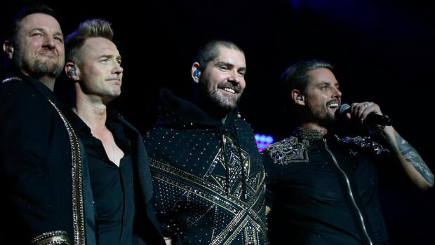 Mikey Graham, Ronan Keating, Shane Lynch and Keith Duffy of Boyzone on stage last night. PHOTO: STEPHEN COLLINS