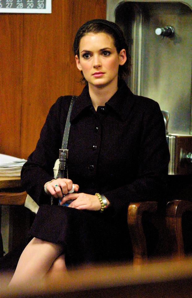 Actress Winona Ryder listens as the verdict is read at the Beverly Hills Municipal Court on the eighth day of her shoplifting trial on November 6, 2002