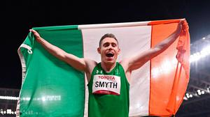 Jason Smyth of Ireland celebrates with the tricolour after winning the T13 Men's 100 metre final at the Olympic Stadium on day five of the Tokyo 2020 Paralympic Games in Tokyo. Photo by Sam Barnes/Sportsfile