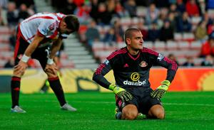Sunderland's Vito Mannone looks dejected after Raheem Sterling (not pictured) scored the third goal for Manchester City