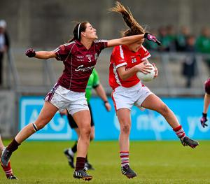 Cork's Eimear Scally gets to the ball under pressure from Galway's Emer Flaherty during their TESCO HomeGrown Ladies NFL Division 1 final