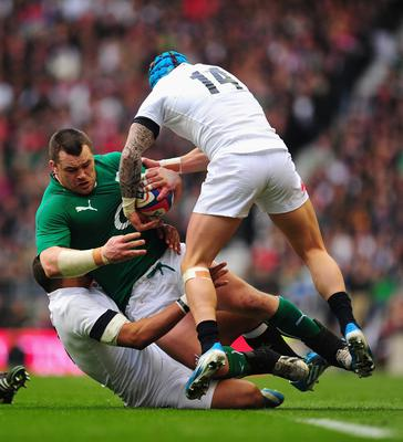 Ireland prop Cian Healy runs into England players Luther Burrell (l) and Jack Nowell