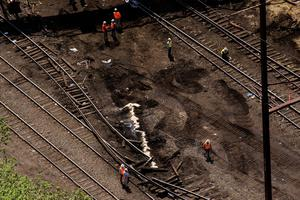 Emergency workers and Amtrak personnel inspect track damage from a derailed Amtrak train in Philadelphia, Pennsylvania May 13, 2015. The commuter rail route where an Amtrak train left the track on Tuesday was not governed by an advanced safety technology meant to prevent high-speed derailments, officials familiar with the investigation said on Wednesday. REUTERS/Lucas Jackson
