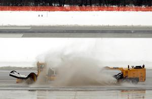 Snow removal equipment is used to clear the runways at Baltimore Washington International Thurgood Marshall Airport outside Baltimore, Maryland