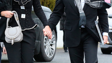 Michael Flatley pictured with his wife Niamh as they arrive at St Molings Church in Glynn Co Carlow for the funeral mass of Michael's mother Elizabeth Flatley. Picture: Frank Mc Grath