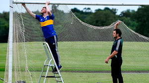 St Sylvester's players Eoghan Manning and Brian Walsh attach netting to the goal before a hurling challenge against St Patrick's Donabate at Malahide Castle last week. Photo: Piaras Ó Mídheach