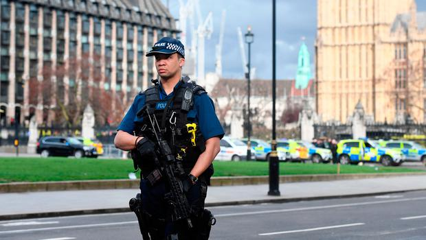 Police close to the Palace of Westminster, London, after policeman has been stabbed and his apparent attacker shot by officers in a major security incident at the Houses of Parliament. PRESS ASSOCIATION Photo. Picture date: Wednesday March 22, 2017. See PA story POLICE Westminster. Photo: Victoria Jones/PA Wire