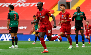 Liverpool's Sadio Mane celebrates scoring his side's first goal. Photo: PA