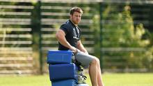 Sean O'Brien watches on during Leinster squad training