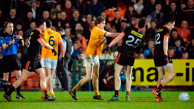 Stephen Beatty of Antrim strikes out at Ciaron O'Hanlon of Armagh. Photo by Oliver McVeigh/Sportsfile