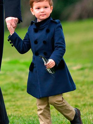 Joseph Kushner, holding a toy Marine One, walks with his grandfather, US President Donald Trump, as they make their way to board Marine One on the South Lawn of the White House in Washington, DC on March 3, 2017.