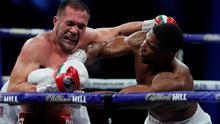 Anthony Joshua in action against Kubrat Pulev during the Heavyweight world title fight at the SSE Arena, London