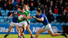 Kevin McLoughlin of Mayo in action against Tony Brosnan and Jack Barry of Kerry
