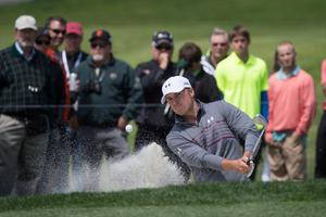 Jordan Spieth hits out of a bunker at the second hole in San Francisco